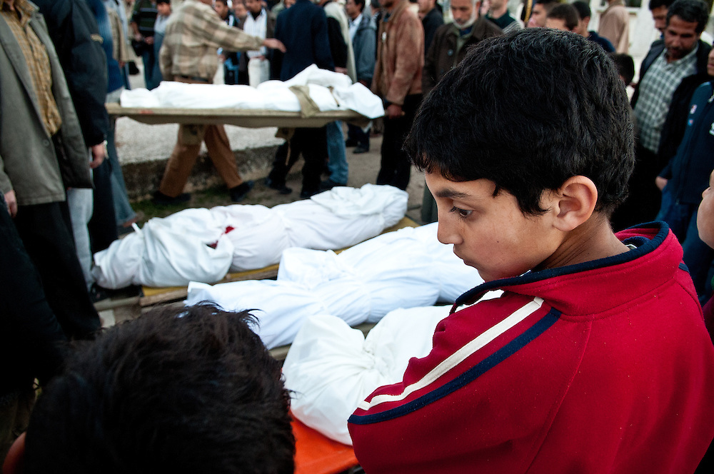 Two young brothers attend a mass funeral at a Gaza City cemetery for 29 members of the Samouni family who were killed during Operation Cast Lead.