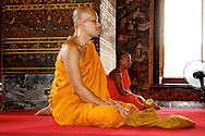 Buddhist monks meditate at Wat Bowonniwetwihan temple has added sacredness due to long-standing connections with the divine royal court, making it especially important to the Thais.
