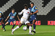Milton Keynes Dons striker Kieran Agard (14) battles for possession  with Wycombe Wanderers midfielder Curtis Thompson(18) during the EFL Trophy match between Milton Keynes Dons and Wycombe Wanderers at stadium:mk, Milton Keynes, England on 12 November 2019.