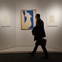 """BRESCIA, ITALY - FEBRUARY 11:  A visitor walks in front of """"Venus"""" by Matisse at the  Santa Giulia Museum on February 11, 2011 in Brescia, Italy. The exhibition """"Matisse La Seduzione di Michelangelo"""" shows  180 works of the French artist and will stay open until June 12th 2011"""