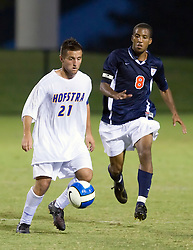 Hofstra midfielder/forward Justin Flood (21) keeps the ball from Virginia Cavaliers forward/midfielder Ross LaBauex (8).  The Virginia Cavaliers faced the Hofstra Pride  in NCAA men's soccer at Klockner Stadium on the Grounds of the University of Virginia in Charlottesville, VA on September 7, 2008