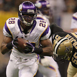 Jan 24, 2010; New Orleans, LA, USA; Minnesota Vikings running back Adrian Peterson (28) runs from New Orleans Saints linebacker Scott Fujita (55) during a 31-28 overtime victory by the New Orleans Saints over the Minnesota Vikings in the 2010 NFC Championship game at the Louisiana Superdome. Mandatory Credit: Derick E. Hingle-US PRESSWIRE