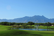 The Santa Rita Mountains of the Coronado National Forest in the Sonoran Desert serve as a backdrop for the Coyote Course at Quail Creek in Green Valley, Arizona, USA.