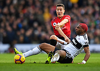 Football - 2018 / 2019 Premier League - Fulham vs. Manchester United<br /> <br /> Fulham's Ryan Babel is fouled by Manchester United's Ander Herrera, at Craven Cottage.<br /> <br /> COLORSPORT/ASHLEY WESTERN
