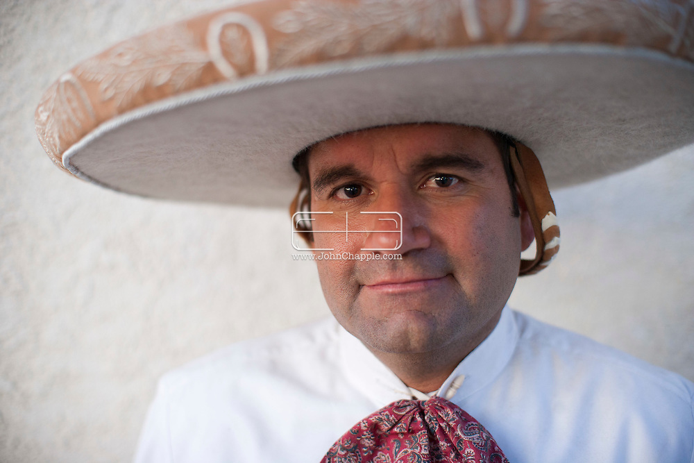 October 1st, 2011. Pico Rivera, California. Traditional charros (Mexican cowboys) compete in a Mexican Rodeo. The competition at the Pico Rivera Sports Arena is a display of horsemanship and lasso skills. Pictured is the Taco man, Carlos Contreras..PHOTO © JOHN CHAPPLE / www.johnchapple.com