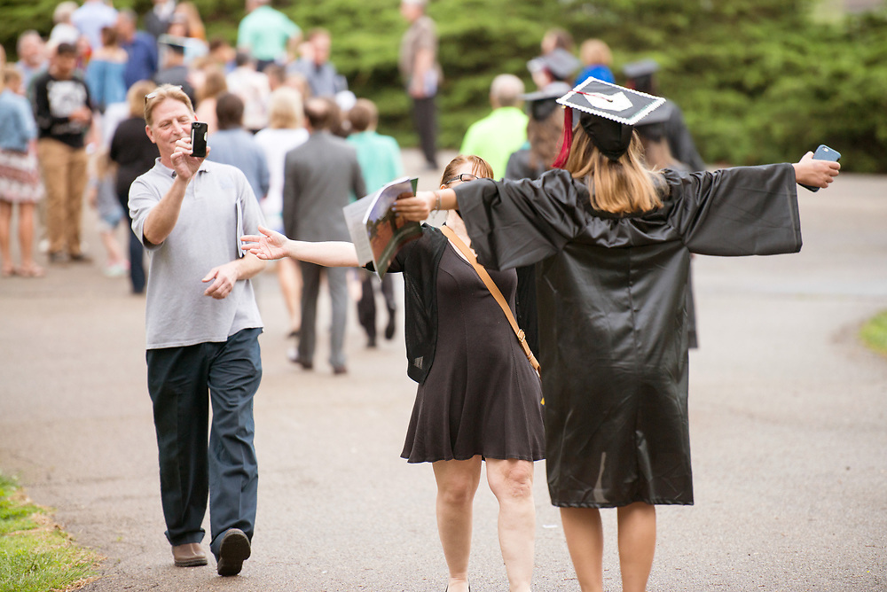 Abby Miller (Right) is greeted by her parents following undergraduate commencement ceremonies. Photo by Ben Siegel