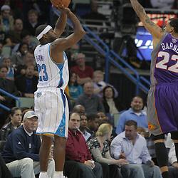 03 December 2008:  New Orleans Hornets guard Devin Brown (23) shoots over Phoenix Suns forward Matt Barnes (22) during a 104-91 victory by the New Orleans Hornets over the Phoenix Suns at the New Orleans Arena in New Orleans, LA..