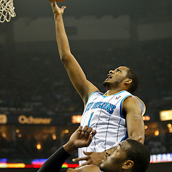 February 1, 2011; New Orleans, LA, USA; New Orleans Hornets small forward Trevor Ariza (1) shoots over Washington Wizards point guard John Wall (2)  during the first quarter at the New Orleans Arena.   Mandatory Credit: Derick E. Hingle
