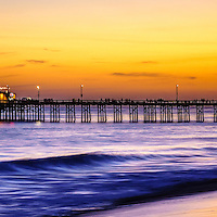 Newport Beach pier panorama photo at sunset. Balboa Pier is located on Balboa Peninsula  along the Pacific Ocean in Orange County Southern California. The pier is a popular attraction for fishing and the Ruby's Diner restaurant at the end of the pier. Panoramic ratio is 1:3.