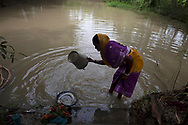 Gauri Moanda, 48, fetches water from a pond  at her organic farm in village in Indroprastha, West Bengal, India Thursday, Oct. 4, 2012 (Photo/Elizabeth Dalziel for Christian Aid)