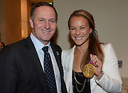 Prime Minister John Key and Olympic Gold Medallist Lisa Carrington. Baseball New Zealand fundraising evening prior to the New Zealand Diamond Blacks Baseball team competing at the World Baseball Classic Qualifier in Taiwan in November. Skycity Grand Hotel, Auckland, Friday 14 September 2012. Photo: Andrew Cornaga/Photosport.co.nz
