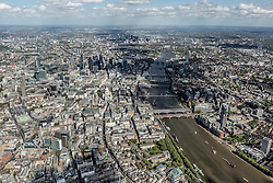 © Licensed to London News Pictures. 26/04/2016. London, UK. Aerial view of central London, from the Embankment, looking along the  River Thames towards The Isle of Dogs.   Photo credit: Martin Apps/LNP