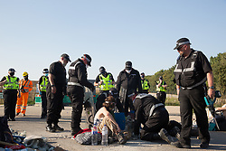 West Hyde, UK. 14th September, 2020. A Hertfordshire Police cutting team works to remove two environmental activists from HS2 Rebellion who used a lock-on arm tube to block a gate to the South Portal site for the HS2 high-speed rail link. Anti-HS2 activists blocked two gates to the same works site for the controversial £106bn rail link, one remaining closed for over six hours and another for over twelve hours.