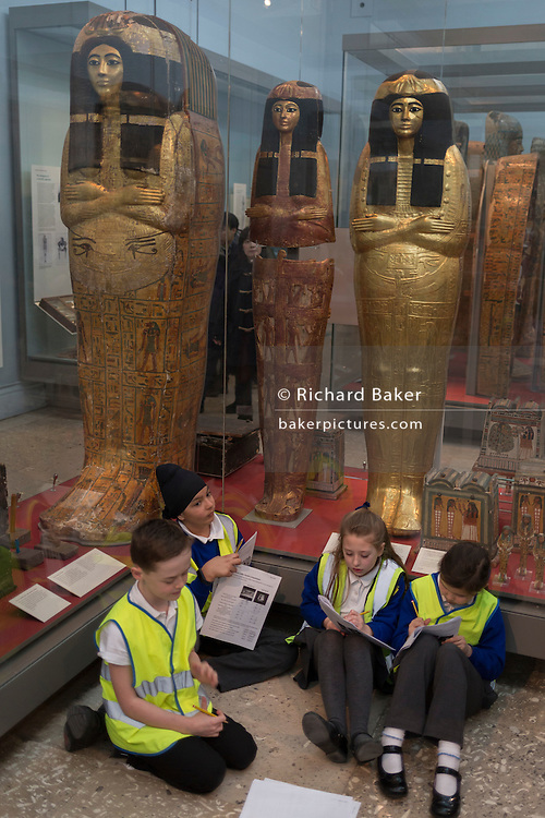 Schoolchildren work on projects beneath New Kingdom (1279-1213BC) Egyptian Mummies of Henutmehyt in the British Museum, on 28th February 2017, in London, England.