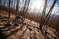 Gordon Wadsworth and Andrew Dunlap mountain biking on trails on Mill Mountain in the Blue Ridge Mountains around Roanoke, Virginia. Mountain biking in the Blue Ridge Mountains. Mountain biking man, woman, kids in virgina, north carolina, montana, and california.