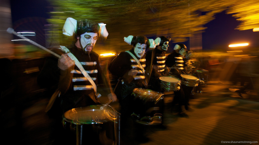 """Basque street performers Deabru Beltzak put on """"Drums of Fire"""" marching randomly around the Xscape, Milton Keynes followed by hundreds of spectators as they drum and set of an amazing pyrotechnic display at IF Milton Keynes International Festival 2012."""