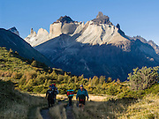 Hike under Los Cuernos (the Horns) in Torres del Paine National Park, Chile. The foot of South America is known as Patagonia, a name derived from coastal giants, Patagão or Patagoni, who were reported by Magellan's 1520s voyage circumnavigating the world and were actually Tehuelche native people who averaged 25 cm (or 10 inches) taller than the Spaniards.