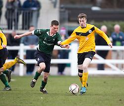 Edinburgh University's Stuart MacFarlane and Edinburgh City's Mark McConnell. <br /> Edinburgh University 0 v 1 Edinburgh City, Scottish Sun Lowland League game played 14/3/2015 at The University of Edinburgh's Peffermill playing field.