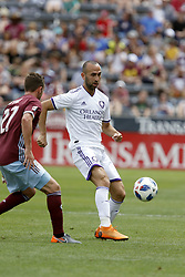 April 29, 2018 - Commerce City, Colorado - Orlando City SC forward Justin Meram (9) passes the ball in the first half of action in the MLS soccer game between Orlando City SC and the Colorado Rapids at Dick's Sporting Goods Park in Commerce City, Colorado (Credit Image: © Carl Auer via ZUMA Wire)