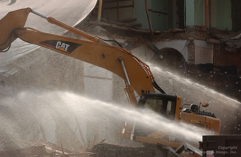 Excavators work to tear down the remaining portions of the former Holy Childhood school building in Harbor Springs.