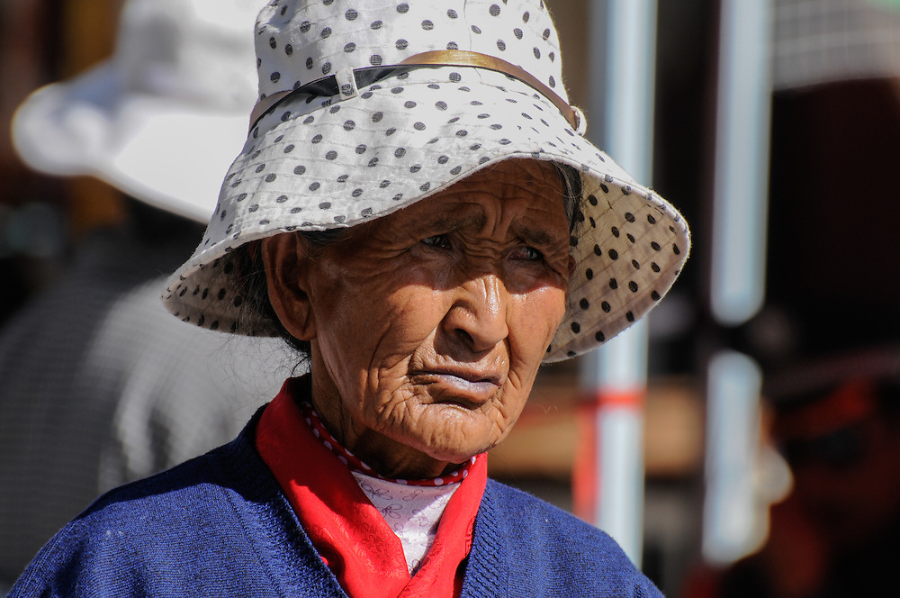 Old woman with wrinkles wearing a hat, Lhasa, Tibet.