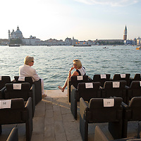VENICE, ITALY - JULY 20:  A couple sits at their reserved places of a luxury hotel on  Giudecca during the Redentore Celebrations on July 20, 2013 in Venice, Italy. Redentore is one of the most loved celebrations by Venetians which is in remembrance for the end of the 1577 plague. Highlights of the celebration include the pontoon bridge extending across the Giudecca Canal, gatherings on boats in the St Mark's basin and a spectacular fireworks display.  (Photo by Marco Secchi/Getty Images)