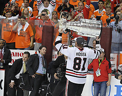 June 9, 2010; Philiadelphia, PA; USA;  Chicago Blackhawks right wing Marian Hossa (81) raises the cup overhead after the Blackhawks defeated the Flyers 4-3 in Game 6 of the Stanley Cup Finals at the Wachovia Center.