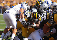 September 4 2010: Iowa Hawkeyes running back Adam Robinson (32) dives through a hole for a 2 yard touchdown run during the first quarter of the NCAA football game between the Eastern Illinois Panthers and the Iowa Hawkeyes at Kinnick Stadium in Iowa City, Iowa on Saturday September 4, 2010. Iowa defeated Eastern Illinois 37-7.