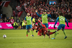 December 9, 2017 - Toronto, Ontario, Canada - Toronto FC forward JOZY ALTIDORE (17) falls from a foul by Seattle Sounders midfielder CRISTIAN ROLDAN (7) while Seattle Sounders defender ROMAN TORRES (29) looks on during the MLS Cup championship match at BMO Field in Toronto, Canada.  Toronto FC defeats Seattle Sounders 2 to 0. (Credit Image: © Mark Smith via ZUMA Wire)