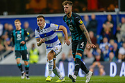 Queens Park Rangers forward Jordan Hugill (9) and Swansea City defender Joe Rodon (4) during the EFL Sky Bet Championship match between Queens Park Rangers and Swansea City at the Kiyan Prince Foundation Stadium, London, England on 21 August 2019.