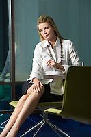 Businesswoman sitting in office portrait