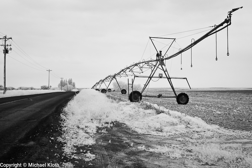 Infrared photograph of an empty pasture and an industrial sprinkler in Mesa, WA.  Fine art photography by Michael Kloth. Black and white infrared photographs