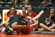 Linn-Mar's Alijah Jeffery (from left) works on pinning Prairie's Sam Uthoff during the 120-pound bout of the dual between Linn-Mar and Cedar Rapids Prairie at Prairie High School in Cedar Rapids on December 12, 2013.