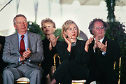 U.S. First Lady Hillary Clinton sits with Journalist Robert MacNeil, left, and Music Director of the Metropolitan Opera James Levine, right, during the National Medal of Arts and Humanities awards during a ceremony on the South Lawn of the White House September 29, 1997 in Washington, DC.