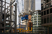 City workers walk past another giant office building Brookfield construction development in the financial district City of London.