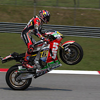 German MotoGP rider Stefan Bradl of LCR Honda lift his tyre at the end of qualifying session of the 2014 Malaysian Motorcycling Grand Prix in Sepang International Circuit near Kuala Lumpur, Malaysia, 25 October 2014. The Malaysian Motorcycling Grand Prix will take place from 24 to 26 October 2014.
