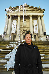 © Licensed to London News Pictures. 29/11/2019. LONDON, UK.  British artist Anne Hardy poses in front of Tate Britain as the new Winter Commission is unveiled.  She has transformed Tate Britain's facade into a marooned temple celebrating the earth, tides and winter solstice.  The installation will be on display until 26 January 2020.  Photo credit: Stephen Chung/LNP