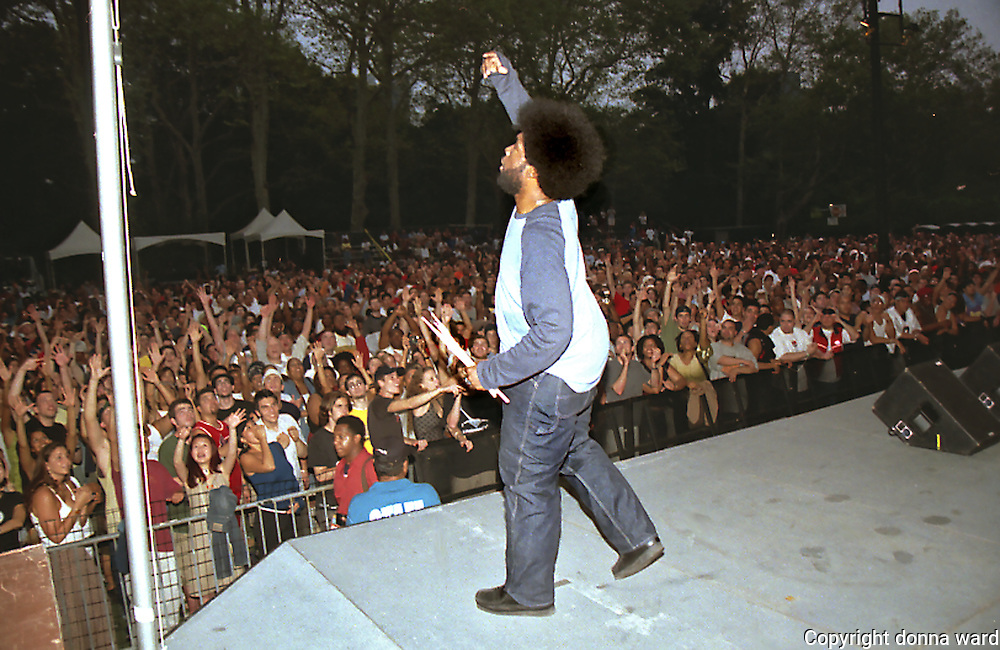The Roots Drummer Questlove throws sticks into the audience  to celebrate SOB's 20th Anniversary at SummerStage in Central Park on September 14, 2002.