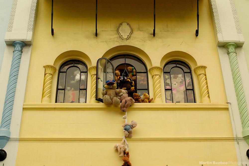 Teddy bears escape from an upstairs window of a shop on New Regent Street, Christchurch, New Zealand