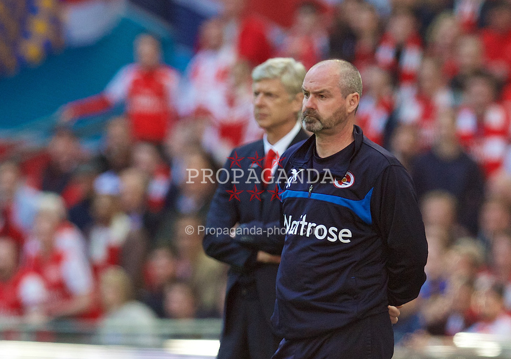 LONDON, ENGLAND - Saturday, April 18, 2015: Reading's Steve Clarke and Arsenal's manager Arsene Wenger during the FA Cup Semi-Final match at Wembley Stadium. (Pic by David Rawcliffe/Propaganda)