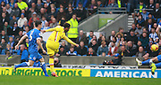 MK Dons striker Nicky Maynard strikes to reduce the deficit during the Sky Bet Championship match between Brighton and Hove Albion and Milton Keynes Dons at the American Express Community Stadium, Brighton and Hove, England on 7 November 2015. Photo by Bennett Dean.