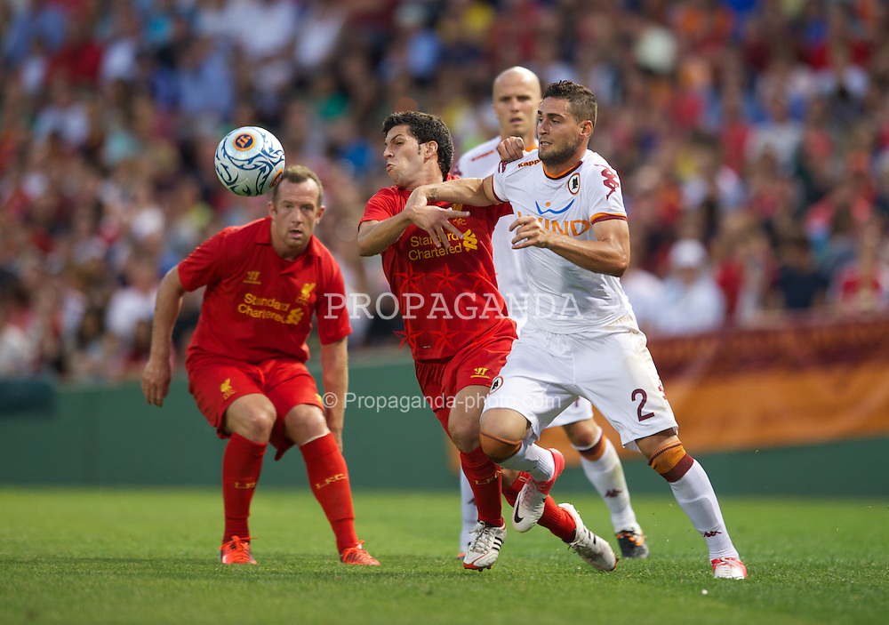 BOSTON, MA - Wednesday, July 25, 2012: Liverpool's Daniel Pacheco in action against AS Roma's Aleandro Rosi during a pre-season friendly match at Fenway Park, home of the Boston Red Sox, the second match of the Reds' North American tour. (Pic by David Rawcliffe/Propaganda)