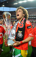 20100509: LISBON, PORTUGAL - SL Benfica vs Rio Ave: Portuguese League 2009/2010, 30th round. In picture:  David Luiz celebrating with the trophy. PHOTO: Alvaro Isidoro/CITYFILES