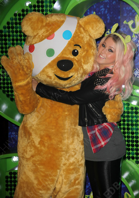 29.OCTOBER.2012. LONDON<br /> <br /> X FACTOR FINALIST AMELIA LILLY JOINS PUDSEY BEAR AT SHREK THE MUSICAL IN THEATRE ROYAL DRURY LANE, CATHERINE STREET, LONDON, TO CELEBRATE HER COLLABORATION IN THIS YEAR&rsquo;S BBC CHILDREN IN NEED POP GOES THE MUSICAL. ON WEDNESDAY 14TH NOVEMBER, AMELIA WILL TAKE TO THE STAGE TO PERFORM A UNIQUE COLLABORATION WITH CAST MEMBERS FROM THE AWARD-WINNING SHREK THE MUSICAL.<br /> <br /> BYLINE: EDBIMAGEARCHIVE.CO.UK<br /> <br /> *THIS IMAGE IS STRICTLY FOR UK NEWSPAPERS AND MAGAZINES ONLY*<br /> *FOR WORLD WIDE SALES AND WEB USE PLEASE CONTACT EDBIMAGEARCHIVE - 0208 954 5968*