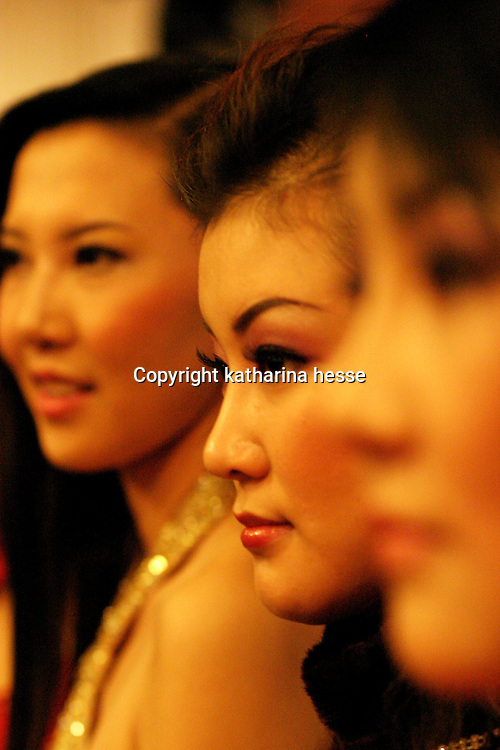 """BEIJING, 12 DECEMBER 2004: Cao Dandan, a 22-year old contestant of the """"first worldwide artificial beauty pageant """" which will be held in Beijing next week, waits during  a press conference in Beijing, December 12, 2003, in China.Organizers dreamed up the pageant after Yang Yuan, , a young woman who paid USD13,000 on cosmetic surgery attemped to sue them for banning her from the finals of a traditional beauty contest last May...Beauty business in China , from cosmetic surgeries to hair brush sales, has amounted to more than USD 7 billion in 2003..."""