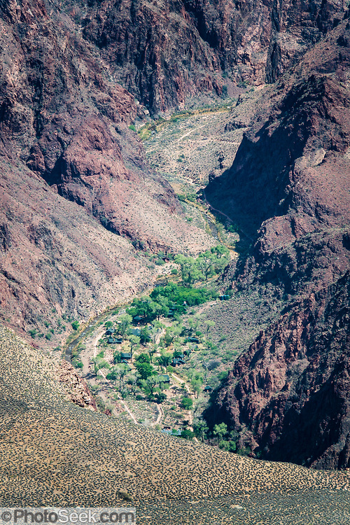 Phantom Ranch and the Colorado River, seen with a telephoto lens from Yavapai Point on the South Rim of Grand Canyon National Park, Arizona, USA. Starting at least 5 to 17 million years ago, erosion by the Colorado River has exposed a column of distinctive rock layers, which date back nearly two billion years at the base of Grand Canyon. While the Colorado Plateau was uplifted by tectonic forces, the Colorado River and tributaries carved Grand Canyon over a mile deep (6000 feet), 277 miles  long and up to 18 miles wide.
