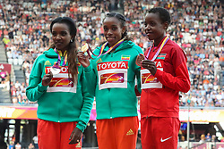 London, 2017 August 06. Almaz Ayana of Ethiopia, gold medalist in the women's 10,000m stands on the podium with Tirunesh Dibaba, Ethiopia (silver) and Agnes Jebet Tirop of Kenya (bronze) on day three of the IAAF London 2017 world Championships at the London Stadium. © Paul Davey.