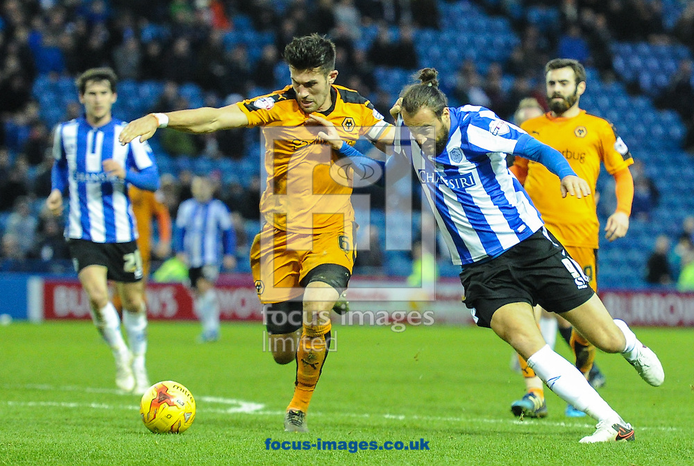 Atdhe Nihiu of Sheffield Wednesday and Danny Batth of Wolverhampton Wanderers during the Sky Bet Championship match at Hillsborough, Sheffield<br /> Picture by Richard Land/Focus Images Ltd +44 7713 507003<br /> 20/12/2015