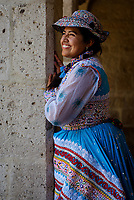 AREQUIPA, PERU - CIRCA SEPTEMBER 2019:  Young Peruvian woman smiling and wearing a typical andrean dress.