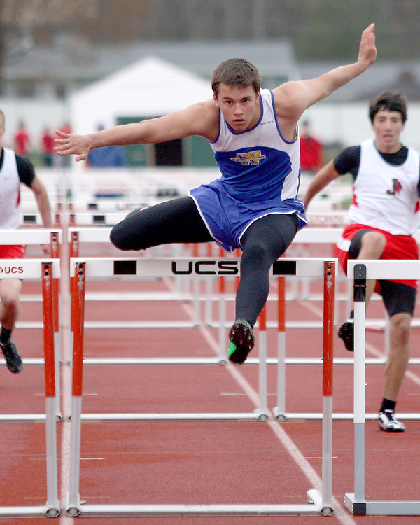 West Seneca's New York Collin Englet en-route to winning the 110 high hurdles against Jamestown New York 5-1-12 photo by Mark L. Anderson